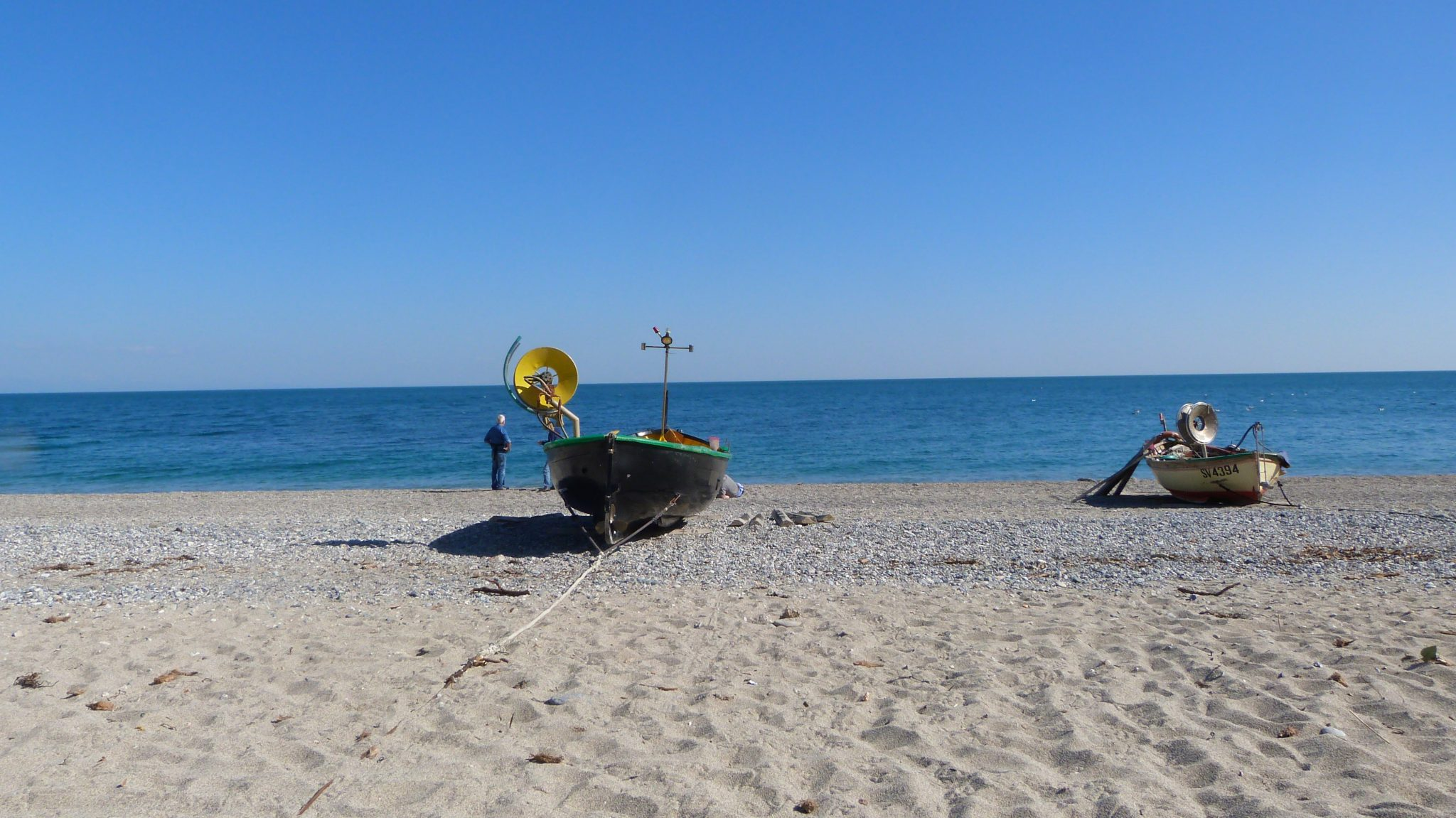 Typical fishing boats on the amazing beach of Noli
